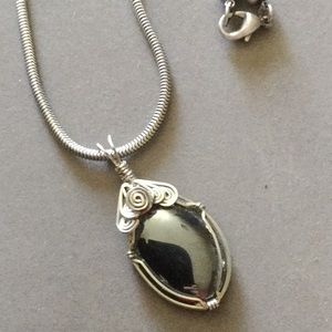 Jewelry - Wire wrapped hematite pendant necklace on a snake